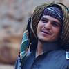 This is a candid portrait of a Bedouin man smiling early in the morning before breakfast.