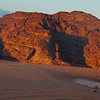 This is a photo rock formations during a spectacular sunset in Wadi Rum.  As a travel photography tip, it's a good idea to not only focus on the sunset.  Look around and you'll often notice other subject areas worth shooting.