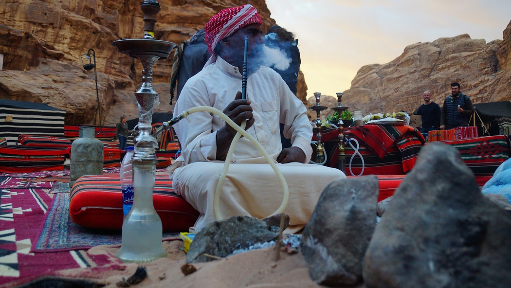 This particular Bedouin man was so photogenic I decided to take one more shot of him smoking Hookah ;)