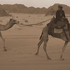 This is an action shot of a Bedouin boy and Dustin Main riding camels in Wadi Rum, Jordan.  You'll notice Dustin wielding his dSLR camera in his hand.  He took a lot of photos of our group which we greatly appreciated.