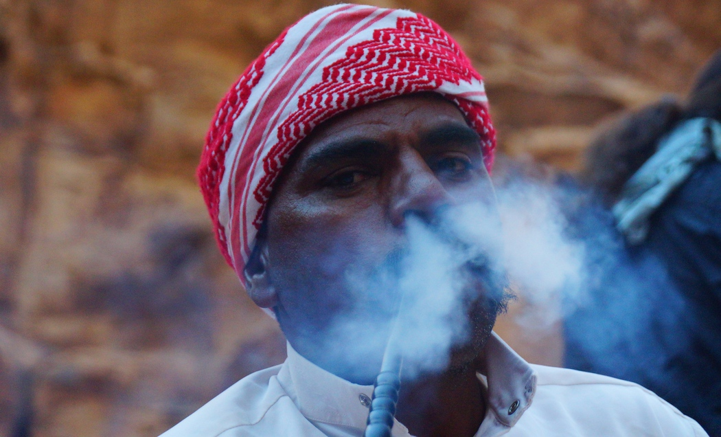 Here a Bedouin man puffs smoke out of his nose just outside of tent in Wadi Rum. Smoking hookah, know locally as Arghila or Shisha, is very common in Jordan. You can select tobacco with an assortment of different flavours. My personal favourite is apple mint.