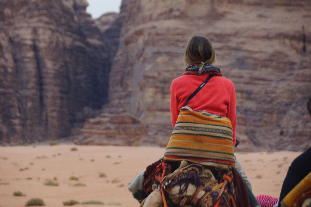 This is a travel image of Audrey Bergner riding a camel for the first time. She did remarkably well and looked rather graceful for somebody with very little experience riding animals.