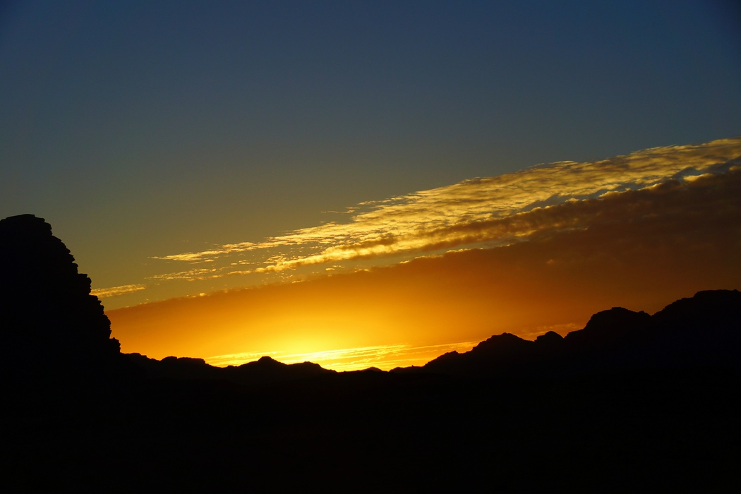 This is a telephoto shot of rock formations during sunset in Wadi Rum, Jordan.
