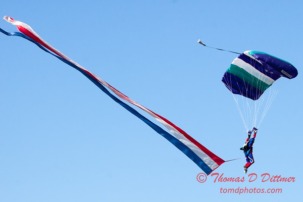 98 - Members of the Liberty Parachute Club drop into the South East Iowa Air Show in Burlington Iowa
