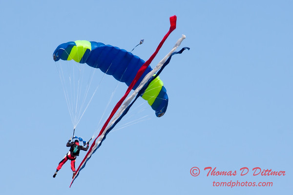 93 - Members of the Liberty Parachute Club drop into the South East Iowa Air Show in Burlington Iowa