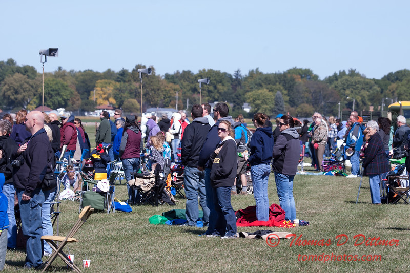 88 - Air show fans and spectators stand in observance of the singing of the National Anthem at the South East Iowa Air Show in Burlington Iowa