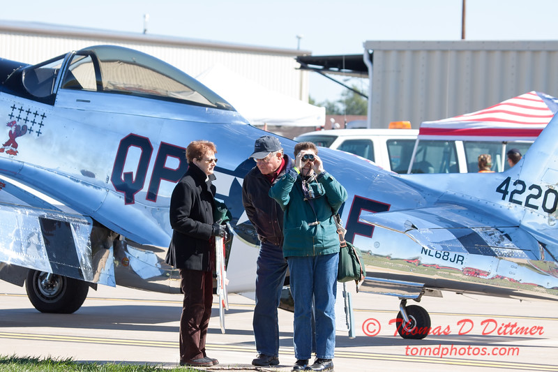 72 - Air show fans and spectators make their way to the showline at the South East Iowa Air Show in Burlington Iowa