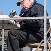 56 - Air Show announcer Phil Dacy prepares for the day's events at the South East Iowa Air Show in Burlington Iowa
