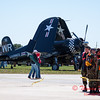 64 - A former US Marine Fighter (F4U Corsair) waits to perform in the South East Iowa Air Show in Burlington Iowa