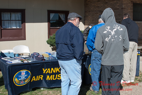 1 - Fans view the memorabilia and merchandise at the South East Iowa Air Show in Burlington Iowa