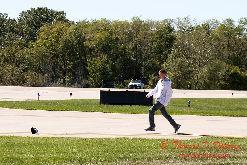 639 - An air show fan chases his hat after assisting Erik Edgren at the South East Iowa Air Show in Burlington Iowa