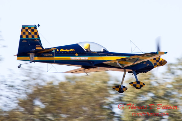 254 - Darrell Massman performs in his S330 Panzl at the South East Iowa Air Show in Burlington Iowa254 - The University of Iowa Operator Performance Laboratory Mil Mi2 Helicopter performance at the South East Iowa Air Show in Burlington Iowa