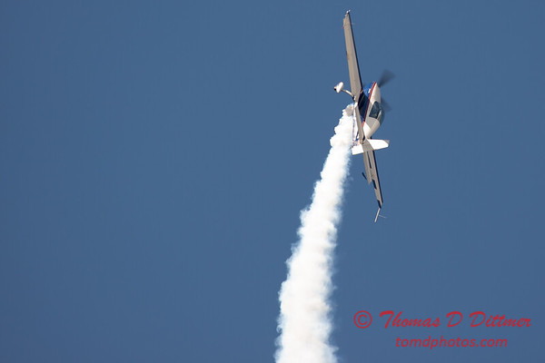 545 - Michael Vaknin in his Extra 300 perform at Wings over Waukegan 2012