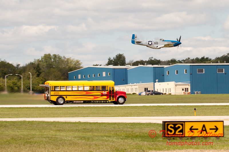 """908 - The """"RACE"""" is on! Paul Stender and the Indy Boys School bus against Vlado Lenoch and his P-51 at Wings over Waukegan 2012"""