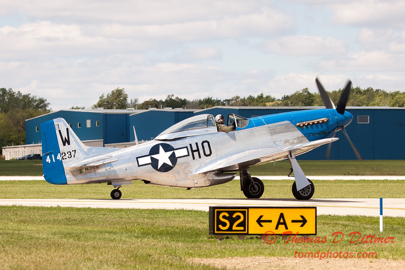 949 - Vlado Lenoch and his P-51 returns to earth at Wings over Waukegan 2012