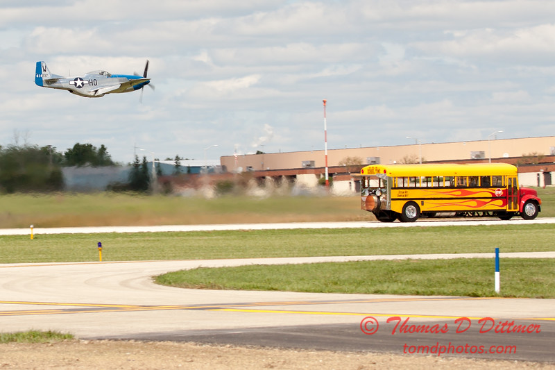 """915 - The """"RACE"""" is on! Paul Stender and the Indy Boys School bus against Vlado Lenoch and his P-51 at Wings over Waukegan 2012"""