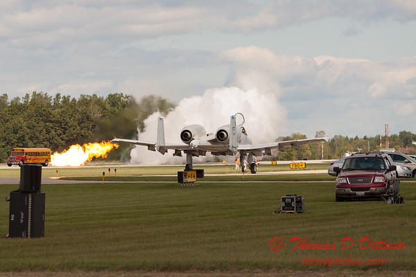 859 - A-10 East taxies to parking with Paul Stender and the Indy Boys School bus in the background at Wings over Waukegan 2012
