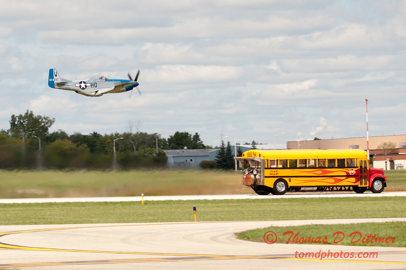 """914 - The """"RACE"""" is on! Paul Stender and the Indy Boys School bus against Vlado Lenoch and his P-51 at Wings over Waukegan 2012"""