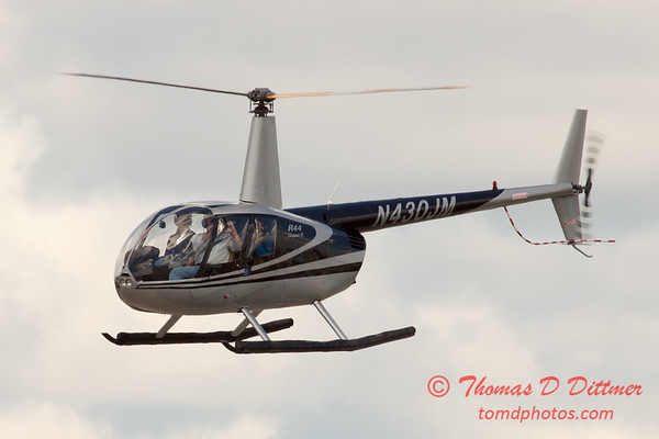 84 - Photographers in a Robinson R44 Helicopter survey Wings over Waukegan 2012
