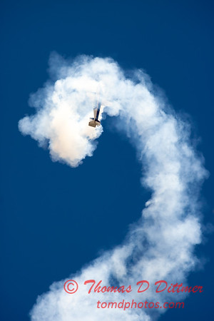 528 - Michael Vaknin in his Extra 300 perform at Wings over Waukegan 2012