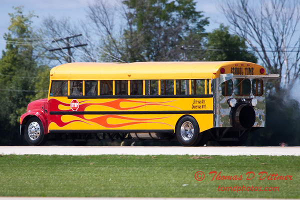 """901 - Paul Stender and the Indy Boys School bus proceeds to the end of the runway in preparation for the """"race"""" against Vlado Lenoch and his P-51 at Wings over Waukegan 2012"""