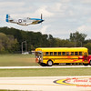 "912 - The ""RACE"" is on! Paul Stender and the Indy Boys School bus against Vlado Lenoch and his P-51 at Wings over Waukegan 2012"
