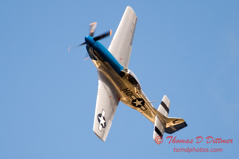 "917 - Vlado Lenoch and his P-51 executes a Victory Roll after the ""race"" with Paul Stender and the Indy Boys School bus at Wings over Waukegan 2012"