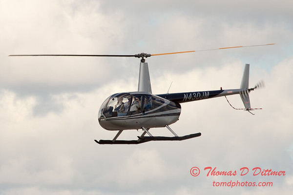 85 - Photographers in a Robinson R44 Helicopter survey Wings over Waukegan 2012