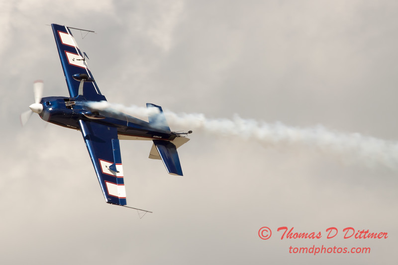 608 - Michael Vaknin in his Extra 300 perform at Wings over Waukegan 2012