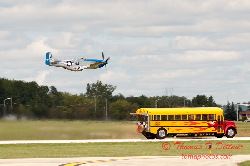 """913 - The """"RACE"""" is on! Paul Stender and the Indy Boys School bus against Vlado Lenoch and his P-51 at Wings over Waukegan 2012"""
