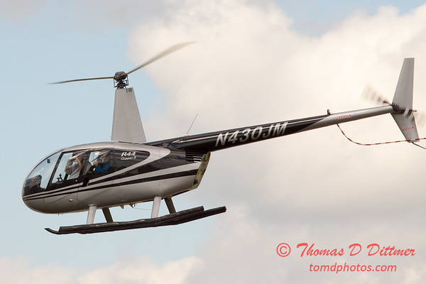 94 - Photographers in a Robinson R44 Helicopter survey Wings over Waukegan 2012