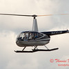 86 - Photographers in a Robinson R44 Helicopter survey Wings over Waukegan 2012