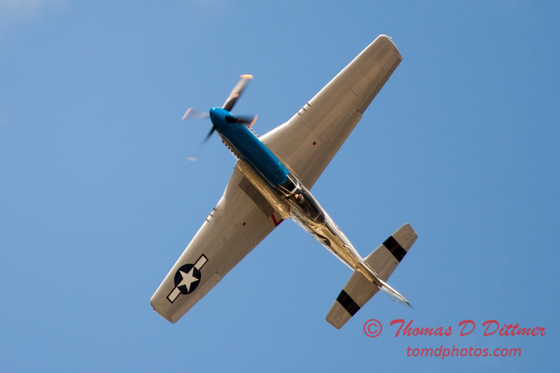 "920 - Vlado Lenoch and his P-51 executes a Victory Roll after the ""race"" with Paul Stender and the Indy Boys School bus at Wings over Waukegan 2012"