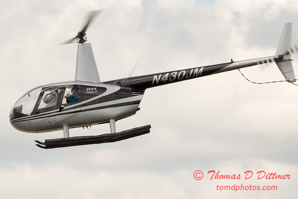 93 - Photographers in a Robinson R44 Helicopter survey Wings over Waukegan 2012