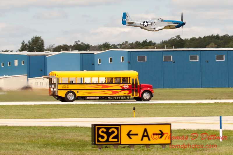 """909 - The """"RACE"""" is on! Paul Stender and the Indy Boys School bus against Vlado Lenoch and his P-51 at Wings over Waukegan 2012"""