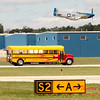 "909 - The ""RACE"" is on! Paul Stender and the Indy Boys School bus against Vlado Lenoch and his P-51 at Wings over Waukegan 2012"