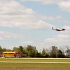 "905 - The ""RACE"" is on! Paul Stender and the Indy Boys School bus against Vlado Lenoch and his P-51 at Wings over Waukegan 2012"