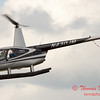 92 - Photographers in a Robinson R44 Helicopter survey Wings over Waukegan 2012