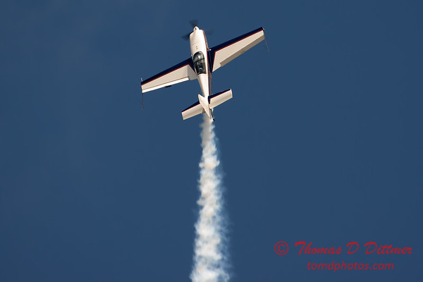 526 - Michael Vaknin in his Extra 300 perform at Wings over Waukegan 2012