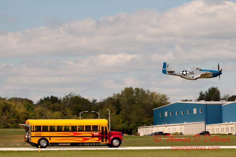 """907 - The """"RACE"""" is on! Paul Stender and the Indy Boys School bus against Vlado Lenoch and his P-51 at Wings over Waukegan 2012"""