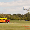 "906 - The ""RACE"" is on! Paul Stender and the Indy Boys School bus against Vlado Lenoch and his P-51 at Wings over Waukegan 2012"