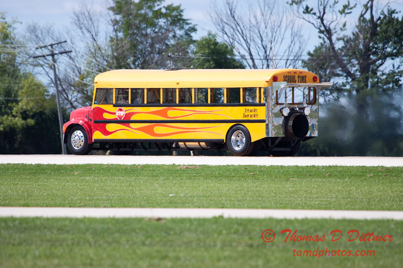 """900 - Paul Stender and the Indy Boys School bus proceeds to the end of the runway in preparation for the """"race"""" against Vlado Lenoch and his P-51 at Wings over Waukegan 2012"""