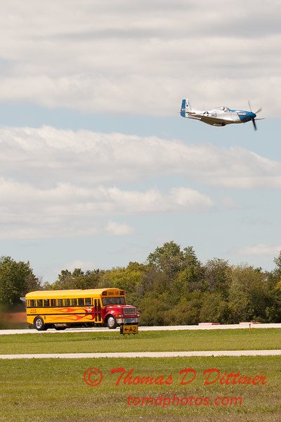 "904 - The ""RACE"" is on! Paul Stender and the Indy Boys School bus against Vlado Lenoch and his P-51 at Wings over Waukegan 2012"