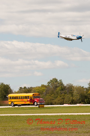 """904 - The """"RACE"""" is on! Paul Stender and the Indy Boys School bus against Vlado Lenoch and his P-51 at Wings over Waukegan 2012"""