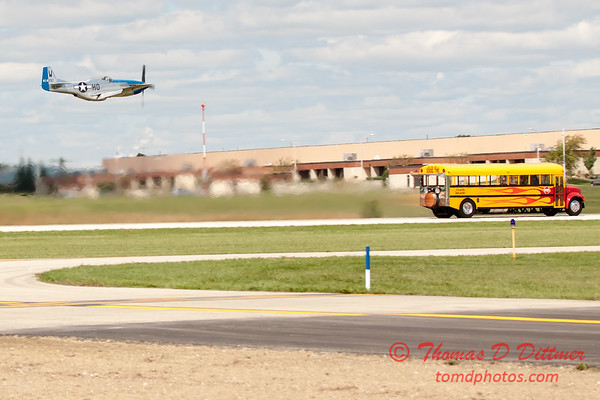 """916 - The """"RACE"""" is on! Paul Stender and the Indy Boys School bus against Vlado Lenoch and his P-51 at Wings over Waukegan 2012"""