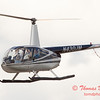87 - Photographers in a Robinson R44 Helicopter survey Wings over Waukegan 2012