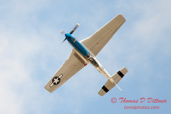 """921 - Vlado Lenoch and his P-51 executes a Victory Roll after the """"race"""" with Paul Stender and the Indy Boys School bus at Wings over Waukegan 2012"""