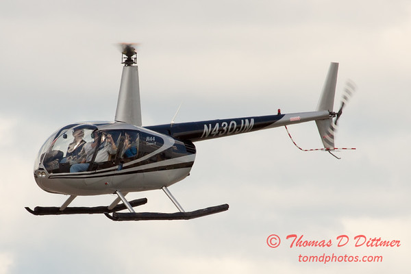 83 - Photographers in a Robinson R44 Helicopter survey Wings over Waukegan 2012