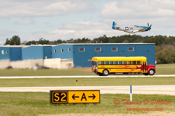 "910 - The ""RACE"" is on! Paul Stender and the Indy Boys School bus against Vlado Lenoch and his P-51 at Wings over Waukegan 2012"