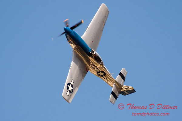 """918 - Vlado Lenoch and his P-51 executes a Victory Roll after the """"race"""" with Paul Stender and the Indy Boys School bus at Wings over Waukegan 2012"""
